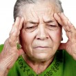 Old senior woman having migraine or headache — Stock Photo #9980786
