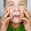 Scared and worried senior woman with wrinkles — Stock Photo