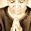 Christian senior woman praying to God - Stock Photo