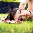 Beautiful feminine woman and flower petals — Stock Photo #9980988