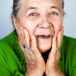 Happy and amazed old senior woman — Stock Photo