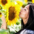Cute young woman and sunflower — Stock Photo