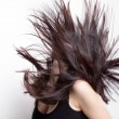 Active woman with hair in motion — Stockfoto