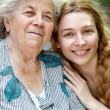 Family portrait of young woman and her grandmother — Stock Photo #9981286
