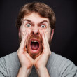Scream of man making an announcement — Stock Photo #9981428