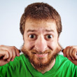 Face of funny silly man — Stock Photo #9981449