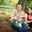 Family portrait - mother father and baby daughter — Stockfoto #9981622