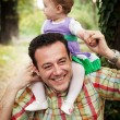 Happy father with his baby daughter — Stock Photo #9981625
