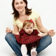Studio portrait of mother and baby daughter — Stock Photo