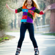 Happy woman on roller skates - Foto Stock