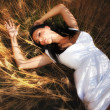 Sexy woman in grain field — Stock Photo #9981787