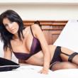 Woman in sexy lingerie posing on bed — Stock Photo #9981853