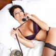 Lingerie sexy woman on erotic phone call — Stock Photo