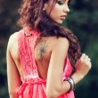 Sensual woman with tattoo on her back — Stock Photo