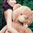 Happy cute woman and her teddy bear — Stock Photo