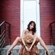 Sexy woman with her teddy bear - Stok fotoğraf