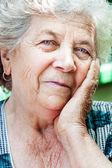 Happy content senior old woman — Stock Photo