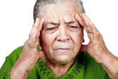 Old senior woman having migraine or headache — Stock Photo
