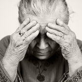 Sad old senior woman with health problems — Stock Photo