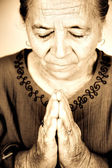 Christian senior woman praying to God — Stock Photo