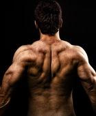 Mannen med muskulösa starka tillbaka — Stockfoto