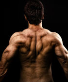 Muž s svalnatý neústupnost — Stock fotografie