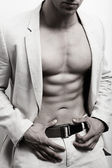 Muscular man with sexy abs and suit — Stock Photo