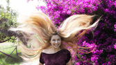 Happy young woman with long blond hair — Stock Photo