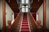Old palace interior - wooden stairs — Stock Photo