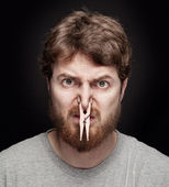 Bad smell concept - peg on male nose — Stock Photo