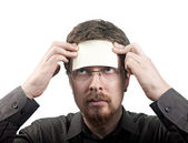 Man with blank note over his forehead — Stock Photo