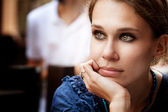 Pensive beautiful woman in the city — Stock Photo