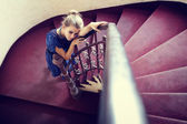 Artistic portrait of elegant woman on stairs — Stock Photo