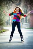 Happy woman on roller skates — Stock Photo