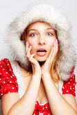 Winter surprise - cute amazed young woman — Stock Photo