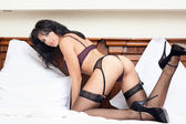 Woman with hot sexy body in bed — Stock Photo