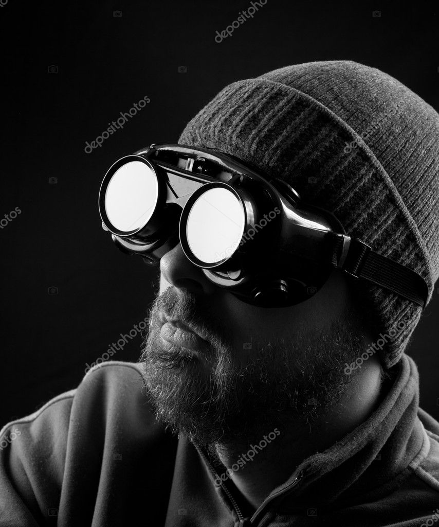 Man wearing protective goggles over black background  Foto Stock #9981429