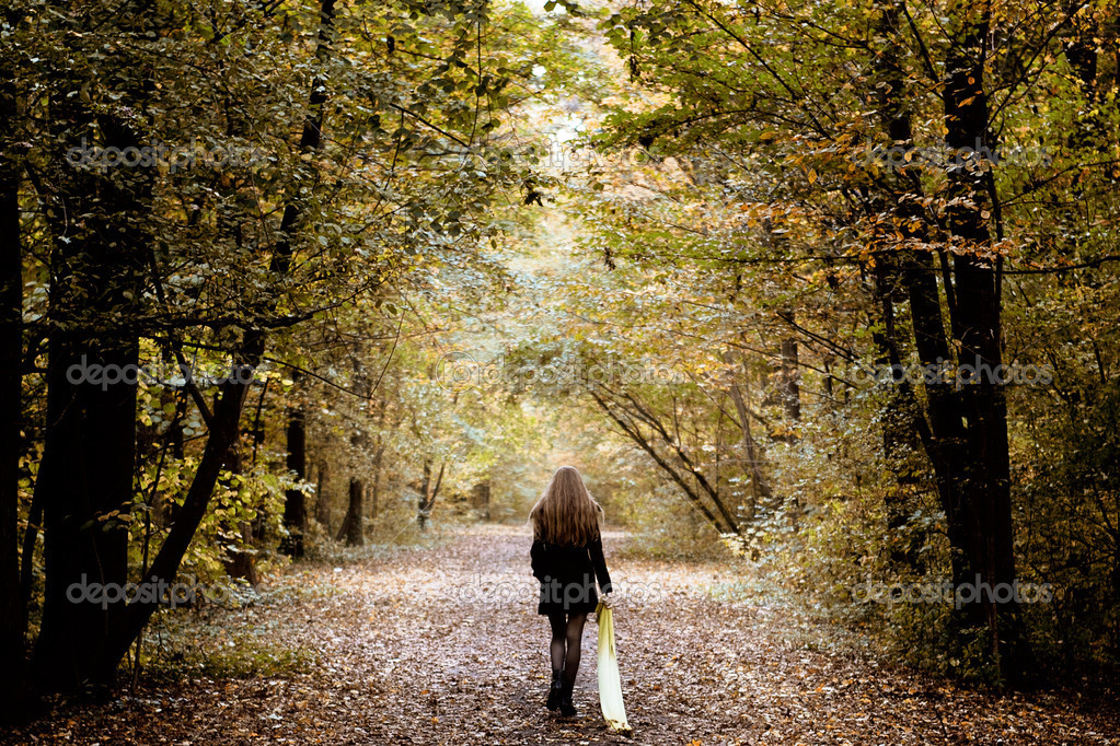 Sad lonely woman walking alone into the woods — Stock Photo #9981514