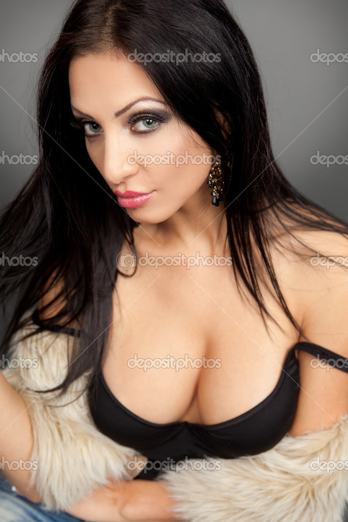 Attractive young woman with sexy cleavage — Stock Photo #9981817