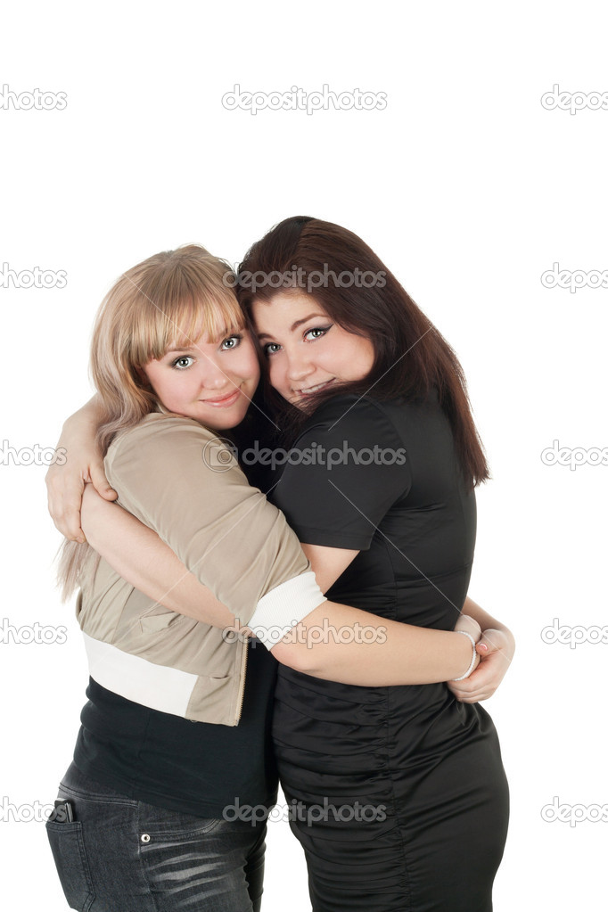 Two female friends embracing  Stock Photo #10489843