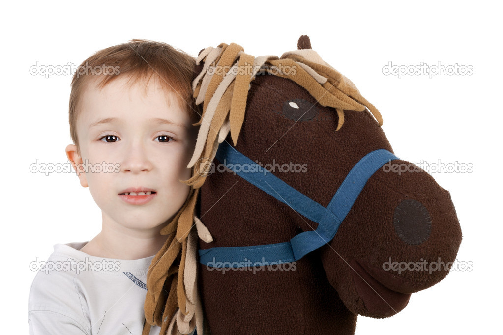Cute little kid with the plush toy horse — Stock Photo #10489868