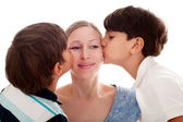 Sons kissing — Stock Photo