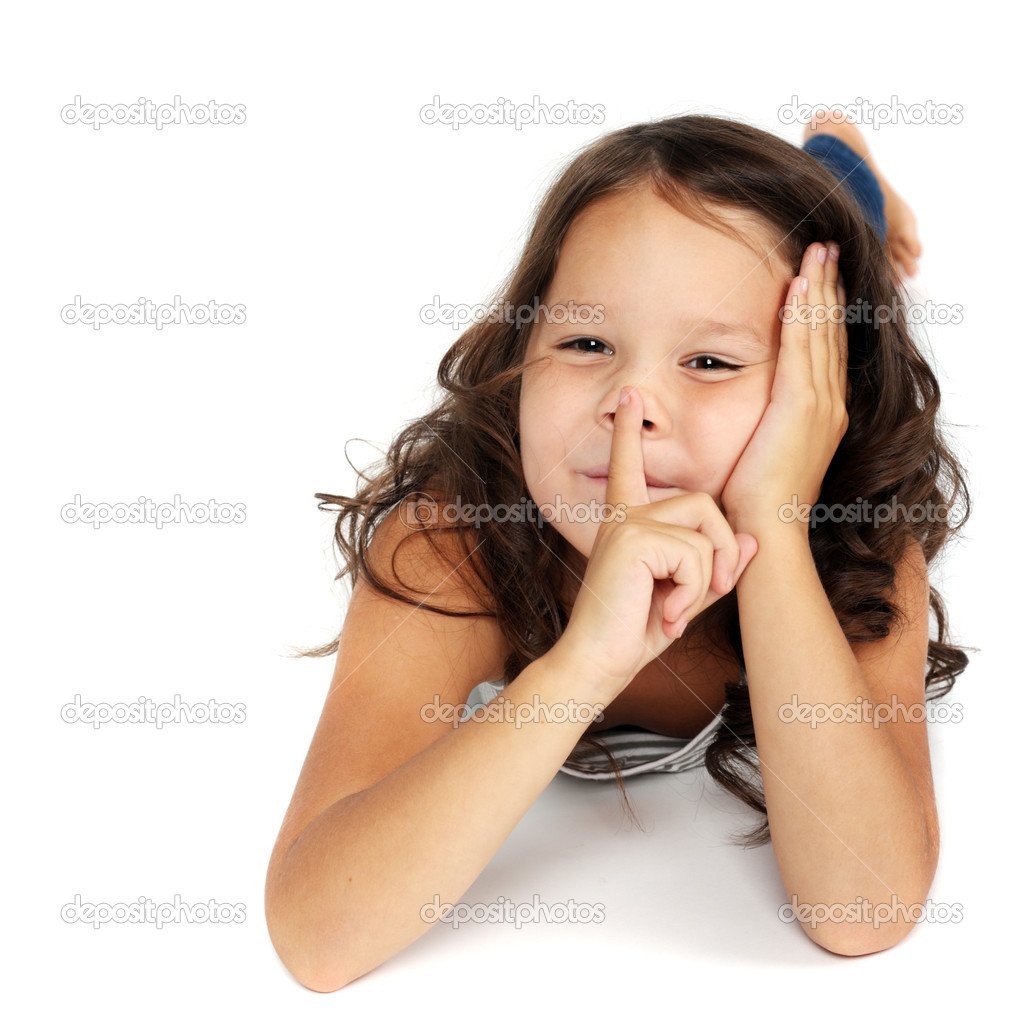 cute little child showing hush sign
