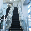 Bright escalator — Stockfoto