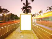 Blank billboard on sidewalk — Stock Photo