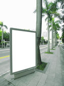Blank billboard on street — Stock Photo