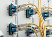 Detail of a modern communications equipment installed in a large datacenter. — Stock Photo