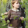 Little boy in spring birch forest — Stock Photo