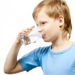 Little boy drink cold water from the glass. — Stock Photo #8449537