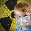 Boy in mask over old Sign of radiation on the concrete grunge station' — Stockfoto